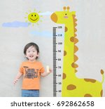 closeup happy asian kid stand... | Shutterstock . vector #692862658