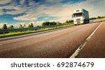 asphalt road on dandelion field ...   Shutterstock . vector #692874679