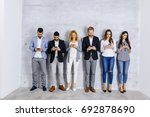 young people with digital... | Shutterstock . vector #692878690