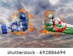 Two fist with the flag of Israel and Algeria faced at each other ready for fight