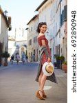 happy woman tourist in a small... | Shutterstock . vector #692890948