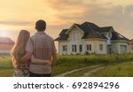 couple looking on house | Shutterstock . vector #692894296