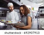 chefs discussing menu on... | Shutterstock . vector #692907913