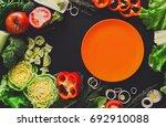 healthy vegetable food on black ... | Shutterstock . vector #692910088