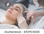 hands of cosmetologist making...   Shutterstock . vector #692915650