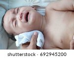 1 year asian baby boy get sick... | Shutterstock . vector #692945200