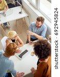 multi ethnic team having...   Shutterstock . vector #692945824