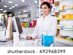 smiling pharmacist ready to...   Shutterstock . vector #692968399