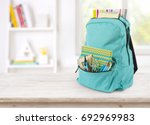 backpack with school supplies... | Shutterstock . vector #692969983