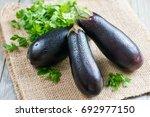 fresh eggplant on wooden... | Shutterstock . vector #692977150