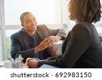 handsome young businessman... | Shutterstock . vector #692983150