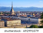 The city center of Turin with Mole Antonelliana tower and Alps mountains panorama, Turin, Italy