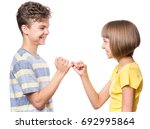 teen boy and girl on the little ... | Shutterstock . vector #692995864