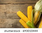 ripe yellow sweet corn cob on a ... | Shutterstock . vector #693010444
