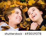 two friends lying on ground in... | Shutterstock . vector #693019378