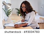 woman working with financial... | Shutterstock . vector #693034783