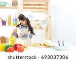 beautiful asian girl kid making ... | Shutterstock . vector #693037306