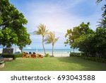 beach chairs with table on the... | Shutterstock . vector #693043588