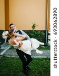 stylish happy bride  groom hold ...   Shutterstock . vector #693062890