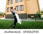 stylish happy bride  groom hold ... | Shutterstock . vector #693062950