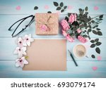 pink roses with blank paper... | Shutterstock . vector #693079174