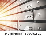 mail boxes filled of leaflets... | Shutterstock . vector #693081520