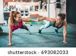 two female friends exercising...   Shutterstock . vector #693082033