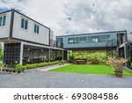modern metal building made from ... | Shutterstock . vector #693084586