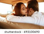close up of an attractive happy ... | Shutterstock . vector #693100690