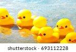 yellow ducks on a beach  | Shutterstock . vector #693112228