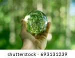 glass globe in the hand | Shutterstock . vector #693131239