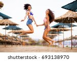 two sexy girls smiling and... | Shutterstock . vector #693138970