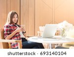 happy woman searching the web... | Shutterstock . vector #693140104