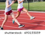 two high school track and field ... | Shutterstock . vector #693155059
