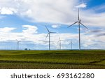 wind turbines in the meadow and ... | Shutterstock . vector #693162280