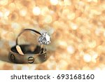 couple wedding rings with... | Shutterstock . vector #693168160