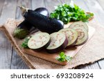 Sliced Eggplant On Wooden...