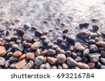 the waves run to the beach over ... | Shutterstock . vector #693216784
