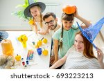 family carving pumpkins | Shutterstock . vector #693223213
