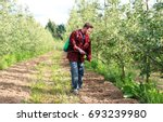 young farmer is spraying... | Shutterstock . vector #693239980