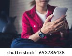 man holding and using mobile... | Shutterstock . vector #693286438