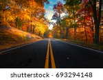 empty road leading through fall ... | Shutterstock . vector #693294148