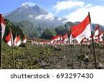 indonesian flag in mount merapi ... | Shutterstock . vector #693297430