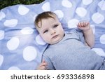 portrait of a young baby boy ... | Shutterstock . vector #693336898
