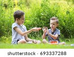 two boys at a picnic outdoors.... | Shutterstock . vector #693337288