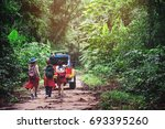 group of people hiking and... | Shutterstock . vector #693395260