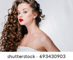 woman with red lipstick. curly... | Shutterstock . vector #693430903