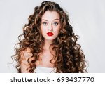 woman with red lipstick. curly... | Shutterstock . vector #693437770