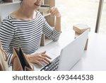 happy woman using smart phone... | Shutterstock . vector #693444538