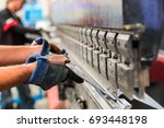 sheet metal bending in factory | Shutterstock . vector #693448198